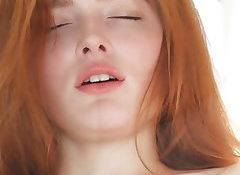 Perfect Rehead Teen enjoys an orgasm